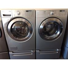 Refurbished  Grey LG Front Load Washer Dryer Set On Pedestals.  Please call store if you would like additional pictures. This set carries our 6 month warranty, MANUFACTURER WARRANTY AND REBATES ARE NOT VALID (Sold only as a set)