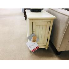 Cream colored side table with door