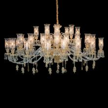 the Vincennes Chandelier Features Etched Glass Hurricane Shades, Gold Accents and Clear Crystal Beads. Delicate Bell Drops and Gold Accents Complement A Clear Frame and Crystal Bead Drapes.