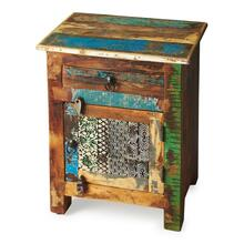 An irresistible combinatinon of rustic charm, vibrant color and intriguing hand-painted design on the door front ensure this piece stands out as original art with benefits -- substantial storage space inside the drawer and behind the door. Crafted from recycled wood solids with wood and iron finished hardware.
