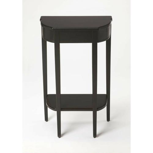 Butler Specialty Company - A spot of elegance for a small space, this console table's harmonious design begins with the slender legs, gracefully tapered. The beautiful symmetry of tabletop and bottom shelf adds to the effect, which is consummated in a Black Licorice finish on cherry veneer.