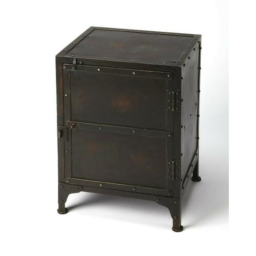 Evocative of a storage locker, this rugged side chest is an inspired addition to any loft space. Forged from iron in a distressed finish, its unembellished design featuring real rivet construction adds industrial flair as chairside or bedside chest. Storage is its added value with a spacious interior with one fixed shelf.