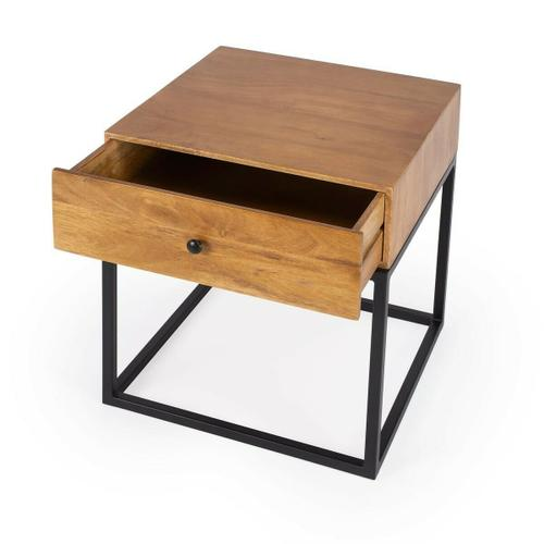 The minimalistic industrial styling of this square end table is an ideal addition in any modern space. Supported by a black finished iron base, its drawer box is constructed from mango wood solids and wood products in a natural finish. With clean lines an