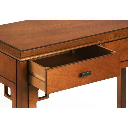 Butler Specialty Company - Modern with a definite Asian flair, this distinctive console table is destined to attract attention in your space. Crafted from bayur wood solids and okoume veneer, it features two drawers with black metal hardware, a lower display shelf and a warm caramel finish.