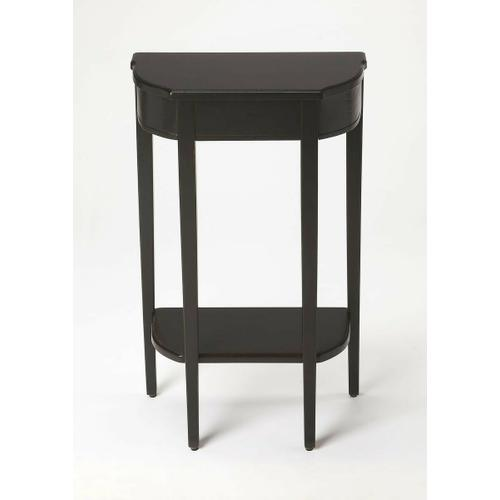A spot of elegance for a small space, this console table's harmonious design begins with the slender legs, gracefully tapered. The beautiful symmetry of tabletop and bottom shelf adds to the effect, which is consummated in a Black Licorice finish on cherry veneer.