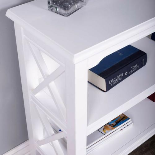 This stylish bookcase is a wonderful accent in a living room, family room, hallway, kitchen, child's room or home office. Made for smaller spaces, versatility is one of its key attributes. Crafted from select hardwood solids and wood products, it features X-shaped side supports and a lovely Cottage White finish. The top and fixed shelves are made from birch veneer.