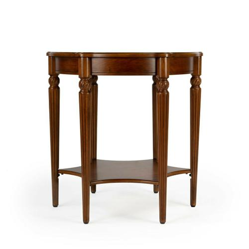 This elegant table blends classic old world styling with today's casual sophistication. Crafted from hardwood solids, wood products and choice veneers, it is distinguished by a top starburst inlay pattern of maple and walnut veneers encompassed by an olive ash burl veneer border. Features beautifully carved fluted legs with a lower display shelf.