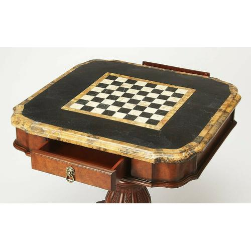 Butler Specialty Company - Fossil stone veneer top and reversible chess/ backgammon game board. Resin components. Game pieces not included. Working drawer.