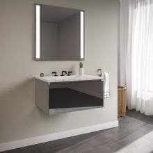 """View Product - Curated Cartesian 24"""" X 15"""" X 21"""" Single Drawer Vanity In Tinted Gray Mirror Glass With Slow-close Plumbing Drawer and Engineered Stone 25"""" Vanity Top In Silestone Lyra"""