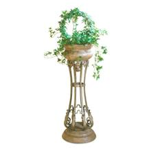 Beautifully crafted from pastor stone and wrought iron. This elegantly designed pedestal planter in a French Provincial style is a goreous accent to any room!