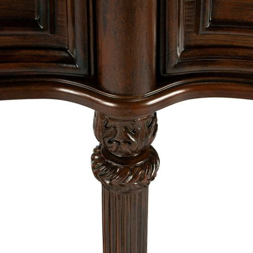 This gorgeous console exudes grandeur. Crafted from select solid woods, wood products and choice veneers, it features a shapely top, lower shelf and drawer fronts all done in cherry veneers. The legs have a fluted design with hand carved acanthus leaf det