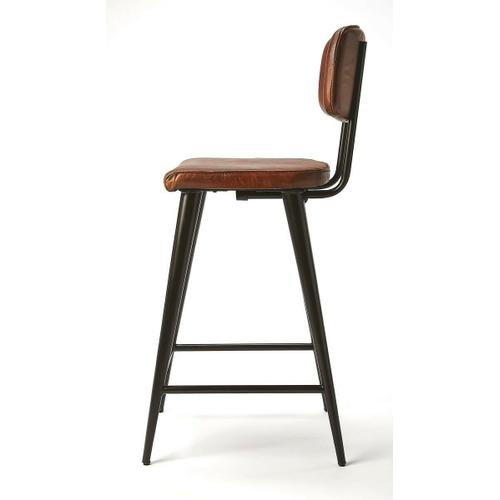 Reminiscient of retro leathers; this bar stool brings a rustic glam to your kitchen, bar or pub ensamble. Comfortable seating with its supple leather adds a touch of retro style to your home decor. Just the right element to refesh and impress with the ap