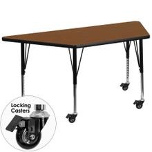 Mobile 25''W x 45''L Trapezoid Oak HP Laminate Activity Table - Height Adjustable Short Legs