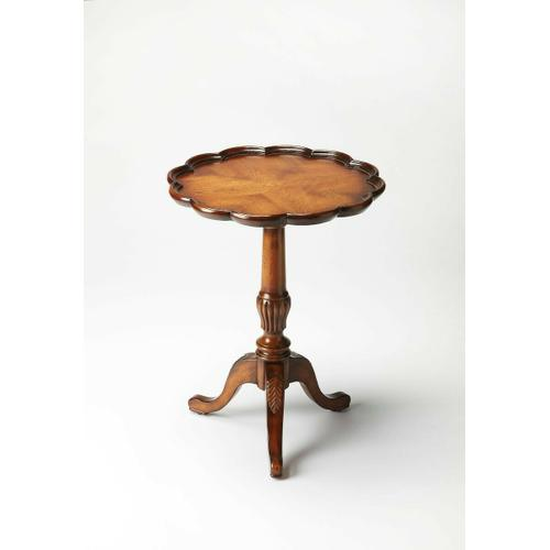 Butler Specialty Company - Add a touch of traditional sophistication to home decor with this lovely round pedestal table. Crafted of solid woods, wood products and Oak veneers, this elegant accent table is the perfect piece to display decorative items. Featuring a Vintage Oak finish, this table boasts a beautiful four-way matched veneer top with scalloped edge. The intricate hand-carved details on the base and legs complete this stunning look.