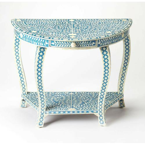 This Demilune console table with intricate bone inlays is a piece of functional art. Crafted from merranti wood solids, resin and wood products by highly skilled artisans, it boasts a captivating botanic pattern formed from thousands of hand-cut and pains
