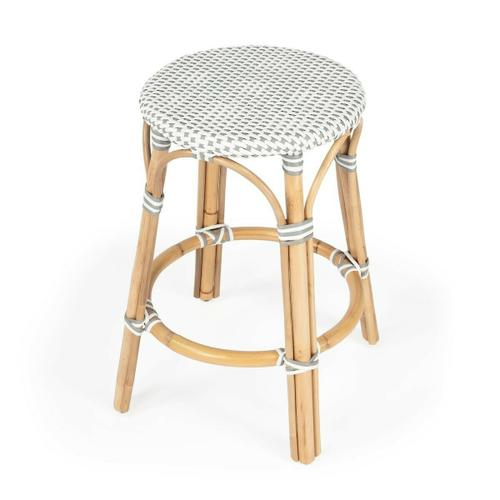 Evoking images of sidewalk tables in the Cote d'Azur, counter stools like this will give your kitchen or patio the casual sophistication of a Mediterranean coastal bistro. Expertly crafted from thick bent rattan for superb durability, it features weather resistant woven plastic in a grey pattern. This backless counter stool is lightweight for easy mobility with comfort to make the space it's in a frequent gathering place.