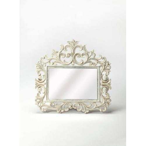 Butler Specialty Company - Accent your entryway or create a lovely focal point above the dresser with this elegant rectangular wall mirror, showcasing a floral scrollwork whitewashed wood frame with lily like details.