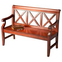 """This alluring transitional bench is a welcome addition to a variety of spaces. Crafted from select hardwoods and wood products, it features bold 'X"""" back supports and a mysterious, lightly distressed Plantation Cherry finish."""