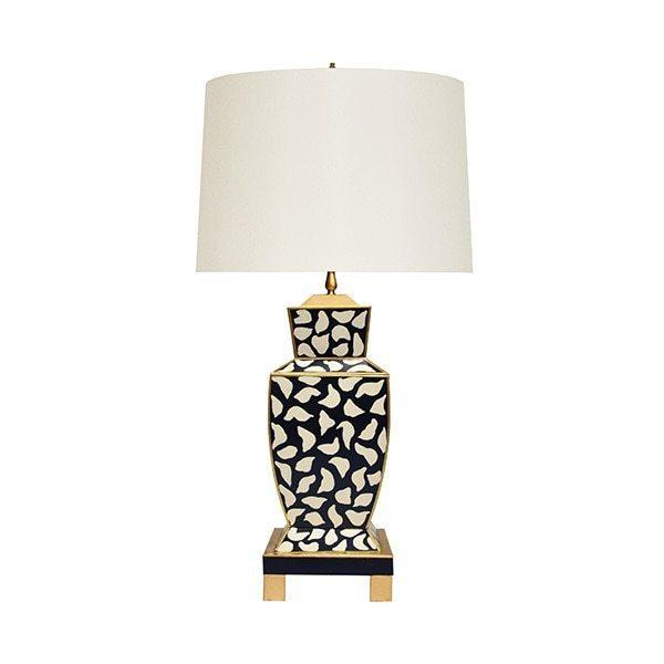 The Extraordinary Bianca Table Lamp Is A Modern Take On A Timeless Classic, Featuring A Distinctive Urn-shaped Base With Hand-painted Tole In Black Leopard. Accented With Gleaming Gold Edges and Floating Atop A Four Leg Base, Bianca Is A Stunning Addition To Brighten Any Room.
