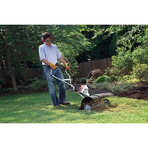 This STIHL YARD BOSS® dethatcher attachment removes dead grass and other accumulated material from the top of the soil.