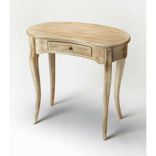 Butler Specialty Company - This elegant Writing Desk features a crescent shape tabletop supported by four stylized, tapered cabriole legs and a drawer with antique brass-finished hardware. It is crafted from solid poplar and cherry veneer in a calming Driftwood finish.