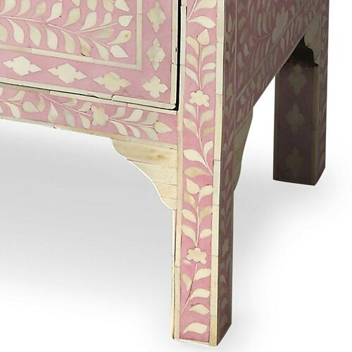 The simple lines and soft, feminine creams and pinks of this accent chest add charm to any space. With two spacious drawers, its front, sides, legs and top are inlayed with opalescent bone in botanical leaf and vine patterns.