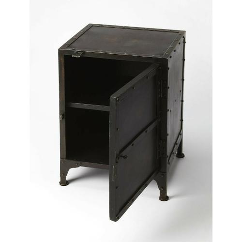 Butler Specialty Company - Evocative of a storage locker, this rugged side chest is an inspired addition to any loft space. Forged from iron in a distressed finish, its unembellished design featuring real rivet construction adds industrial flair as chairside or bedside chest. Storage is its added value with a spacious interior with one fixed shelf.
