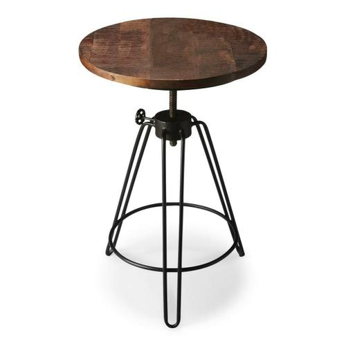This innovative accent table rotates and adjusts to the desired height. Its distressed solid recycled wood top is a perfect complement to the black iron industrial-look base with three exaggerated-U-shaped legs conjoined by a circular stretcher.