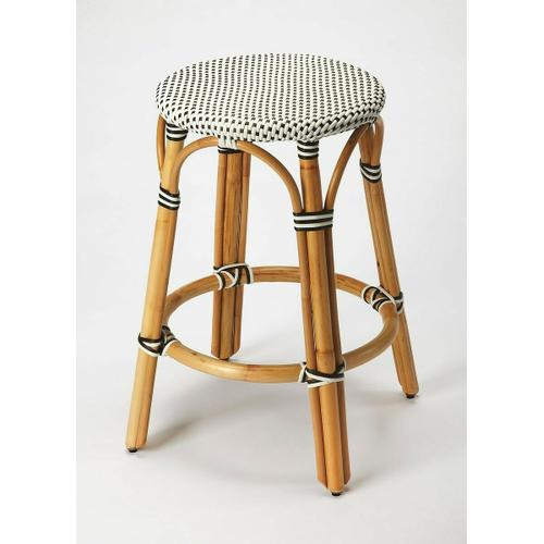 Evoking images of sidewalk tables in the Cote d'Azur, counter stools like this will give your kitchen or patio the casual sophistication of a Mediterranean coastal bistro. Expertly crafted from thick bent rattan for superb durability, it features weather resistant woven plastic in a black and white striped pattern. This backless counter stool is lightweight for easy mobility with comfort to make the space it's in a frequent gathering place.