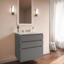 """View Product - Curated Cartesian 24"""" X 7-1/2"""" X 21"""" and 24"""" X 15"""" X 21"""" Three Drawer Vanity In Matte Gray Glass With Tip Out Drawer, Slow-close Plumbing Drawer, Full Drawer and Engineered Stone 25"""" Vanity Top In Quartz White (silestone White Storm)"""