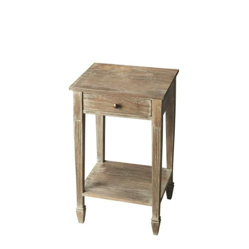 Crafted from acacia wood solids and wood products, this side table features exquisitely tapered and fluted legs ending in ballerina feet ™ all in the rustic Toasted Marshmallow finish. A drawer with complementary brass-finished hardware provides conveni