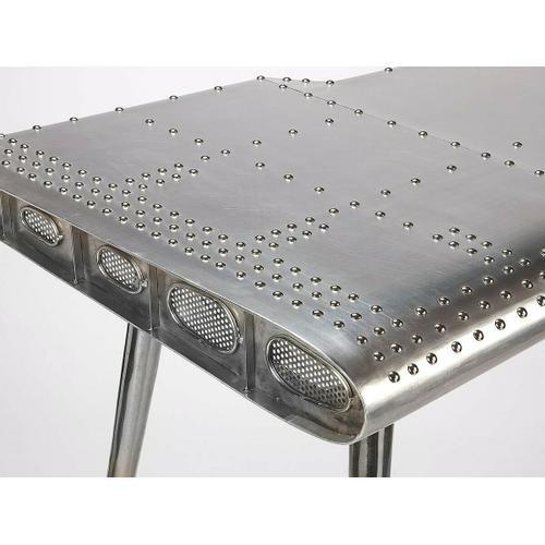 This Pub Table is riveting; soaring with the flair of an airplane wing and guaranteed to help a room soar to new heights. Crafted from polished aluminum and rivets; which detail this shimmering pub table which soars atop four matching taper legs that guarantee a smooth landing. This will move your guests to a higher altitude of envy.