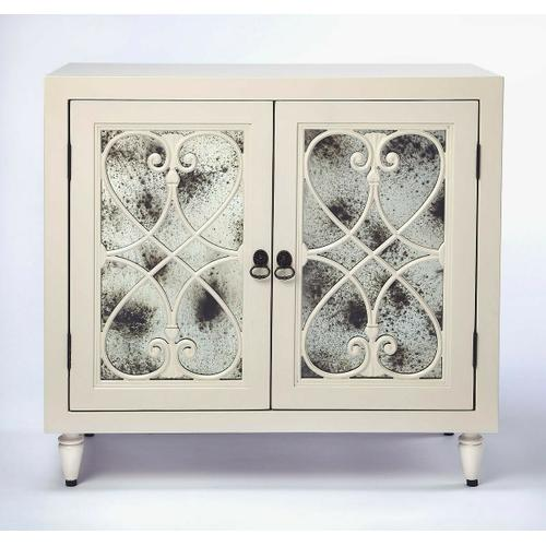 From filling empty corners with personality to keeping essentials stowed in reach and out of sight, this sophisticated statement piece will be a hit in your entry or dining room. Its pair of doors steal the show; each sporting distressed antique mirrored glass panels, ring pulls, and elegant scrollwork. Set it in the dining room to stow your favorite stemware and bottles of wine, then top it with a tray of cocktail mixers to create an impromptu home bar at your next soiree.