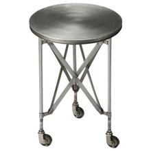 View Product - Crafted from iron and perched on rolling casters; this platinum hued industrial chic accent table evokes the charm of a by-gone era. This table features a distinctive interlaced base linking legs and table top.