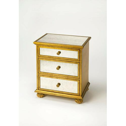 This glamourous chest with mirrored top and front and complementary gold leaf finished trim, makes a strong style statement while providing abundant storage. It offers three drawers. Hardware is finished in sophisticated antique brass. Crafted from hardwood solids and wood products, this chest is a beautiful addition in any bedroom, living room or entryway.