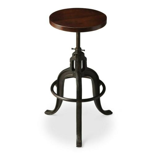 This early industrial-look barstool revolves and adjusts to the desired height, making it an ideal seat for all sizes and tables. With a dark brown finished recycled wood seat, its three-legged design ensures stability and iron circle base serves as a convenient foot-rest. Crafted entirely from iron and recycled wood solids.