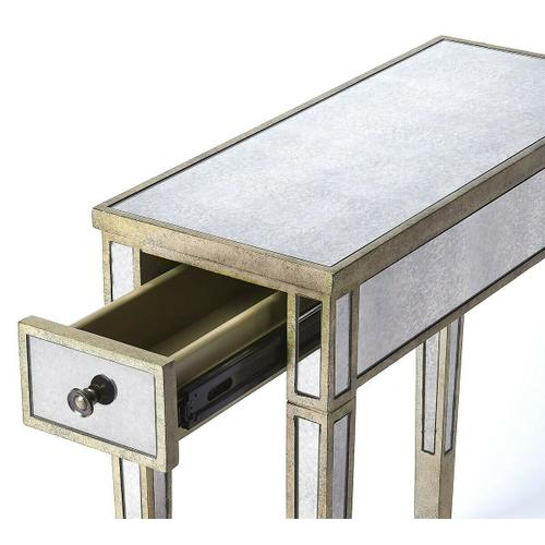 Butler Specialty Company - Add a touch of elegance and class to your home. This one drawer accent table boasts of an elegant antique pewter finish wood surrounded by mirror glass with the element of storage. The elegant tapered legs lends an updated look to a vintage style. Crafted in birch wood solids finished in an antique pewter and offer antique finish mirror glass that reflect a style of true class. This will make a large statement in any room of your home.