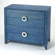 See Details - Bring a little of the outdoors in with this blue raffia clad chest. This raffia clad accent chest adds convenient storage space and great looks in any room. Dressed in a ocean blue finish, the piece features four storage drawers with a silver finished crescent drawer pull can double as an nightstand or small dresser.