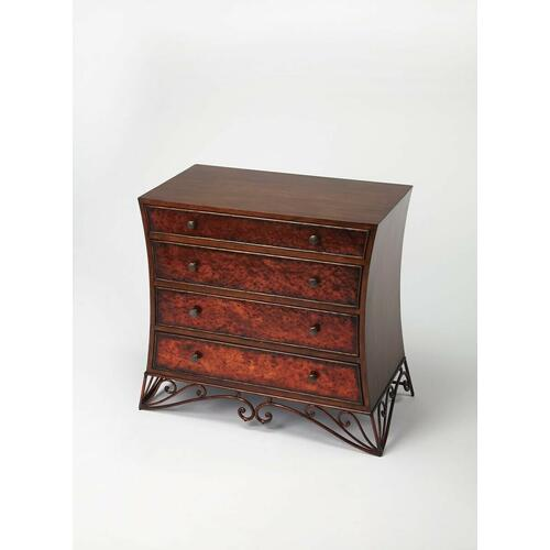 This stylish four drawer chest is sure to be a bright spot in your space. Featuring hammered copper fronts with antique brass finished hardware and a copper finished metal base, the chest is beautifully contrasted by a robust Americano brown wood finish o