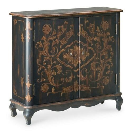 Unique hand painted design on selected hardwoods and wood products. Two doors with one adjustable shelf behind. Antique brass finished hardware.