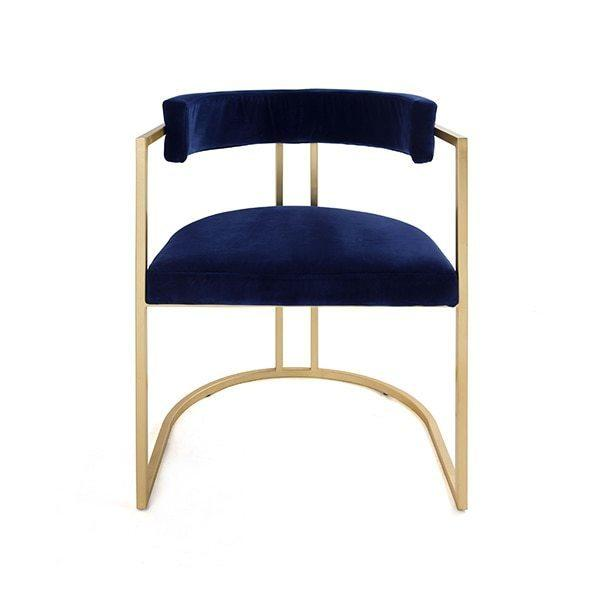 Airy, Refined, and Reminiscent of Old Hollywood, Our Mona Barrel Back Dining Chair Brings Modern Glamour To Any Interior. Lush Midnight Blue Velvet Upholstery Rests Gently On A Hand Finished Gold Leaf Frame.