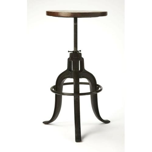Butler Specialty Company - This early industrial-look barstool revolves and adjusts to the desired height, making it an ideal seat for all sizes and tables. With a dark brown finished recycled wood seat, its three-legged design ensures stability and iron circle base serves as a convenient foot-rest. Crafted entirely from iron and recycled wood solids.