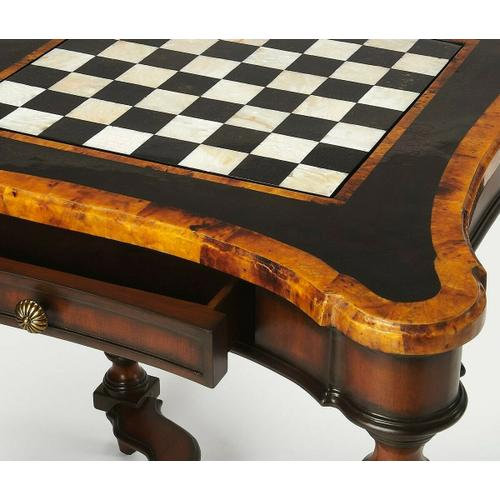 Play games in style with this exquisitely designed and handcrafted game table. Its mahogany finished turned legs and carved stretcher set the stage for the swooping curves and polished penn shell inlays of the magnificent tabletop. The reversible game boa