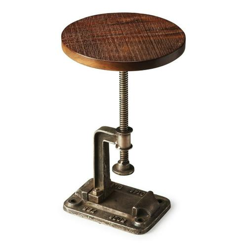 This industrial strength Accent Table is crafted from solid steel in a rich bronze finish. It features an adjustable pedestal with a lightly distressed solid-wood top in a complementary deep brown finish. The height can be adjusted by rotating the table top clockwise or counter-clockwise. The threaded post turns through the opening that's part of the support arm bolted to the base.