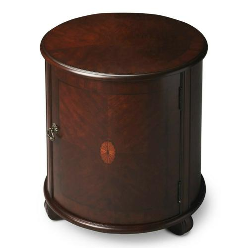 Butler Specialty Company - This beauty of this classic drum table is in its simplicity. The matched cherry veneer top and door with a maple and walnut veneer linen-fold inlay framed within a cherry veneer border are complemented by a rich Plantation Cherry finish. Handcrafted from select hardwood solids, wood products, choice cherry veneers and antique brass hardware, it boasts ample storage, including an adjustable shelf, inside.