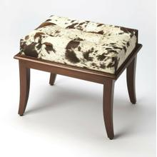 This unique stool will stylishly enhance your space. Featuring a modern loft aesthetic, it features a hair on hide, button tufted cushion and beech wood solids.