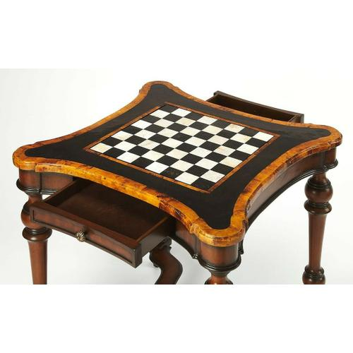 Butler Specialty Company - Play games in style with this exquisitely designed and handcrafted game table. Its mahogany finished turned legs and carved stretcher set the stage for the swooping curves and polished penn shell inlays of the magnificent tabletop. The reversible game board, also created from penn shell inlays, plays chess and checkers on one side, and backgammon on the other. Two drawers with antique brass finished hardware provide for convenient storage of game pieces (which are not included).