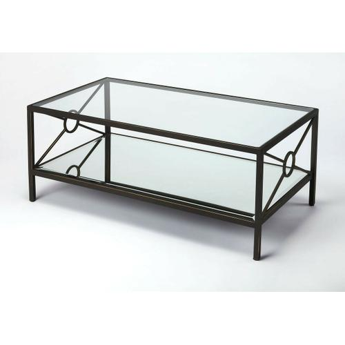 Butler Specialty Company - A great addition to the living room or den. This rectangular coffee table is crafted from Iron and MDF. The tempered glass top and beveled mirrored glass bottom shelf is held together by X-shaped metal bars with an open circle in the middle. The subtle gold accents on the black iron gives this transitional piece an elegant look.