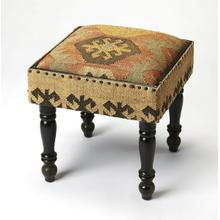 Imbued with Southwestern and Bohemian design influences, this unique stool is a comfy place to rest your feet and store your stuff. Made from acacia wood solids and wood products, it is upholstered in a colorful jute fabric with black nail head trim to match its black turned legs. Its urethane foam cushioned lid lifts off to reveal a handy storage compartment.