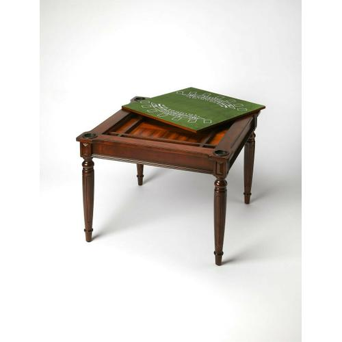Play a variety of games on this stylish table that is veneered with a Plantation Cherry finish. The top inset has a game board for chess and checkers. Flip the inset over and it converts to a green felt-lined blackjack table. Remove the insert altogether and the well (beneath the inset) is a back-gammon game board. Four glass holders on each corner. Chess and other game pieces are not included.